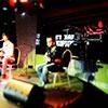 Концерт-съёмка в «Горбушкином дворе». Звучит песня «Кокарда». Фотограф: Михаил Грушин. 24.11.2012.